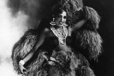 circa 1930: American singer and exotic dancer Josephine Baker (1906 - 1975), of the Parisian Folies Bergere, poses in one of her many elaborate costumes. (Photo by Hulton Archive/Getty Images)